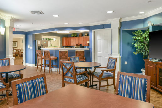 Blue and brown community kitchen and dining area