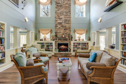 Nicely decorated lounge room with high ceilings and fireplace